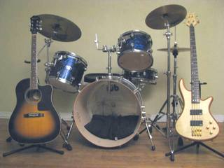 Guitar, bass guitar, and drum lesson
